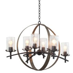 The Irvine Collection features hand forged tapering iron bars hand painted in Vintage Iron with Volcano Nickel finish accents. Thick, hand blown clear glass shades supported by knurled knobs complete the industrial feel of these artisan pieces. Candle Chandelier, Chandelier Shades, Vintage Chandelier, Chandelier Lighting, Ceiling Fan, Ceiling Lights, Ceiling Fixtures, Iron Chandeliers, Vintage Iron