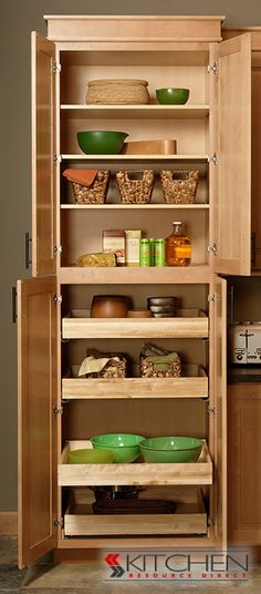 Another example of roll out drawers with the slide mechanism under the drawer - save width space for narrow cabinet