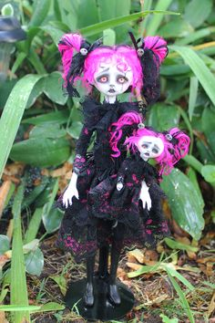 This is Fushia.  She is a faux broken doll. She is a posable soft body doll.  Her head, hands, and feet are made of polymer clay