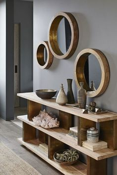 Round mirrors are held by thick wooden frames that evoke the glamour of a luxury liner. Shiny brass trim on the inner rim accentuates the clean and simple desig #luxuryinteriordesign #HallOfMirrors