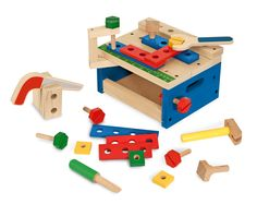 "The 32 pieces in this wooden building set include nails to pound with the hammer, screws to turn with the screwdriver, and panels to connect and saw apart. Best of all, the tools and building supplies store neatly in a compact wooden workbench with measuring surface and C-clamp! Little builders can follow the included ""blueprints"" to create an animal, house, robot, or boat, or create their own amazing structures!"
