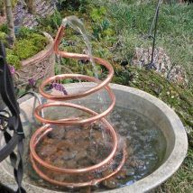 7 Soothing DIY Garden Fountain Ideas Definitely want a water feature, maybe or even A DIY water feature project for the winter months so I'll be ready next spring! Diy Water Fountain, Diy Garden Fountains, Water Garden, Lawn And Garden, Fountain Ideas, Fountain Garden, Homemade Water Fountains, Wall Fountains, Drinking Fountain