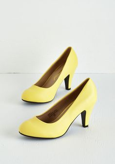 In a Classic of Its Own Heel in Yellow. Many shoes have eye-catching patterns or flirty designs, but sometimes the most basic pumps - like these yellow heels - can become your very favorite. #yellow #modcloth