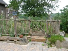 Garden fence idea, made from fallen tree branches.