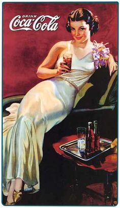 There's nothing I like better than slipping into a sexy satin frock and lounge around the house enjoying my delicious Coca Cola