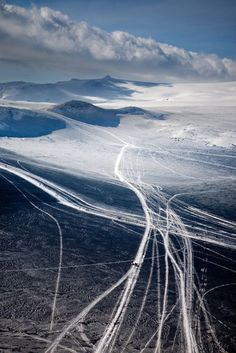 Vehicle tracks on Eyjafjalla glacier to a volcano eruption site, Iceland