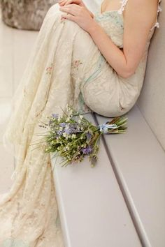 Textured dress w/ rustic lavender colored bouquet, unknown photographer