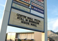 The road sign still advertising Centre Mall Pizza among the final days of the mall's accessibility to the public.