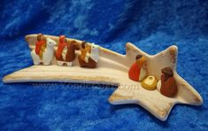 """A fun variation on the nativity story!  Peruvian Wise Men follow the star – literally – on their way to see the Holy Family. Shooting star scene is crafted of ceramic and measures 7.5""""L x 3""""W x 1.5""""H."""