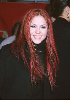 Pin for Later: Shakira's Hair Evolution From Redheaded Rebel to Caramel-Blond Mom April 1999 Yes, this is Shakira! She wore these bright red, crimped locks to the 1999 Alma Awards.
