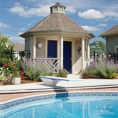 Even a small building adds to the fun of having a pool. Install a bathroom, a small kitchen, or even just a couple of changing rooms, and make it a structure you'll enjoy looking at whenever you're entertaining or using the pool area.