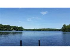 """Extraordinary opportunity to own 1.4 picturesque waterfront acres on the shore of beautiful Bare Hill Pond with boating and swimming from your own private dock. Tucked back on a gentle slope to enjoy sunsets and breathtaking views, this is a very special spot for summer fun and a perfect place to call home. Storybook 3 bedroom cottage with original stone fireplace and loads of character is situated well off scenic street that with a little work can be used """"as is"""" or while making plans to…"""