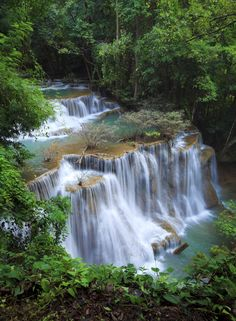 Swim in the Erawan Waterfalls in Thailand. | 41 Adventures To Add To Your Bucket List