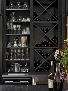 Design Ideas for Kitchen Shelving and Racks: Indulge in luxury. Specialized open cabinetry is a wonderful way to give a prized collection of china, silver, fine wines or other items the pride of place it deserves. Here, X-shaped inserts keep bottles organized, while the shelves for barware are tailored to the heights of the different pieces. A dramatic black finish underscores the elegant effect. From DIYnetwork.com