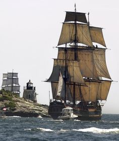 In this July 9, 2012, file photo, a replica of the historic ship HMS Bounty, right, sails past a lighthouse, center, as it departs Narragansett Bay and heads out to sea off the coast of Newport, RI. Bounty was lost to Superstorm Sandy in October 2012.