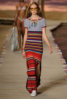 Tommy Hilfiger Spring/Summer 2016 this dress is a maxi dress usually worn in the spring with a summer touch to it the vibrant colours of the stripes bring out the youthfulness in the look.the statement necklace seems to go with the look.the shoes on the other hand is flat and ready to wear a long period of time. the item that complete the look is the shades that goes with the outfit.