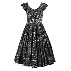 1950's Galanos Black Lace Cocktail Dress | From a collection of rare vintage evening dresses at http://www.1stdibs.com/fashion/clothing/evening-dresses/