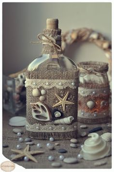 Bottles decorated with burlap and shells