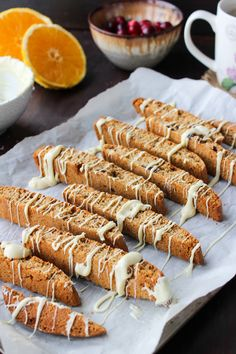 Cranberry Orange Biscotti - made with oat flour, fresh orange zest, and drizzle with white chocolate | gluten free