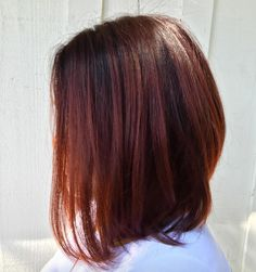 Nothing says fall is here like the perfect shade of dark auburn Aveda hair color. Work by stylist Hollie Matute. Color formula in comments.