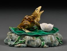 Minton Majolica Frog Dish and Cover, England, 1862, lid modeled as a lily with a frog and the dish modeled as rocks.