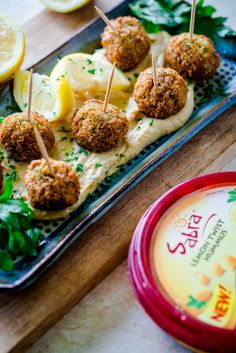 Falafel Bites with Sabra's Lemon Twist Hummus. A delicious one-bite appetizer for summer entertaining!