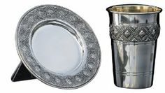 Silver Plated Kiddush Cup with Saucer and Rug Design by World of Judaica. $57.00. Material: Silver Plated. You will be pleasantly surprised! The vast majority of our shipments arrive within 10-14 business days from time of shipment, far in advance of Amazon's default calculation of shipping times for items shipped from Israel.. Your order includes 1 item(s).. This Kiddush Cup and saucer set are plated in silver over a copper base and intricately designed with images reminis...