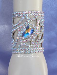 Ballroom Bracelet made with Swarovski crystals in a swirl pattern This bracelet is 3 inches wide and has a rubberized backing that keeps it from moving around while you dance. It has be beautiful swir