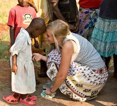 A young missionary brings new pink shoes to a child in Uganda...beautiful!