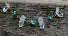 A beautiful quartz and turquoise necklace on a slender 14K gold filled chain. Clear quartz is known as the master healer and will amplify energy. It