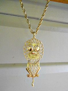 Vintage 70's moveable brass Lion pendent and chain by houuseofwren,