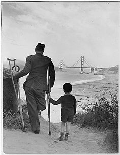 Disabled veteran and child looking out at the San Francisco Golden Gate Bridge, ca. 1943. Repository: Franklin D. Roosevelt Library (Hyde Park, NY)