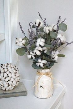 Vintage Farmhouse Decor 15 a cozy arrangement with cotton, eucalyptus and lavender is ideal for a rustic wedding - Weddingomania