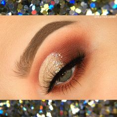 Glittery half cut crease using red and gold tones with the Modern Renaissance Palette. Look by @heather.arndt on IG/YT