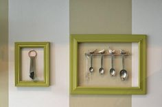 Antique pewter teaspoons hanging in a frame. Love the birds.
