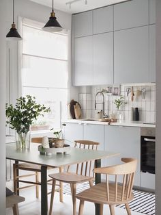 Scandinavian kitchen style is well-known for its simple appearance. the vibe of your kitchen, buying a contemporary table as furniture would Grey Ikea Kitchen, Kitchen Desks, Grey Kitchens, New Kitchen, Cool Kitchens, Kitchen Dining, Kitchen Wood, Kitchen White, Remodeled Kitchens