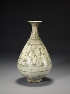 Buncheong Bottle, Joseon dynasty (1392–1910), 15th century, 14.7 inches in height. In the November 2014 issue of Ceramics Monthly Sam Chung discusses how his work has changed throughout his career and some of the major influences behind his work. Chung mentions that he is currently focusing back on traditional Korean bottle forms, particularly the rice-bale bottle forms from the Joseon Dynasty. http://ceramicartsdaily.org/ceramics-monthly/ceramics-monthly-november-2014/