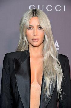 Kim Kardashian Ash-blonde Long Center Part Kim Kardashian looked stylish with her slightly wavy ash-blonde tresses at the 2017 LACMA Art + Film Gala. #ashblonde#haircolor#hair#hairtrend