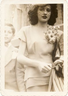 1945. Gorgeous.  check out the size of that corsage!!
