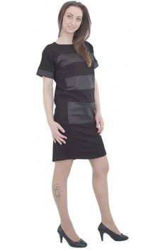 Black dress with wide panels of faux leather and manchets. The dress has a short zip and a slit on the back. The model is with short sleeves. The dress is with closed neckline.