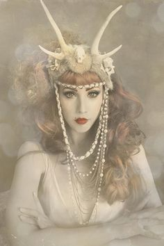 A glamorous Antler ed head Head piece with pearls and lace.