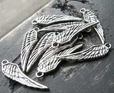 add on sterling silver angel wing charm by yourcharmedlife on Etsy, $6.00
