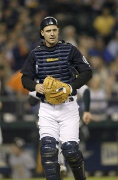 SEATTLE - SEPTEMBER 30:  Catcher Dan Wilson #6 of the Seattle Mariners walks on the field during a game against the Oakland Athletics on September 30 2005 at Safeco Field in Seattle Washington. The Mariners won 4-1.