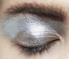 buddhabrot:   Prada Spring/Summer 2011  whatd they do to her eyebrows tho