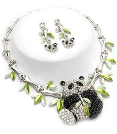 Beautiful necklace and earrings jewelry set designed with black and white, crystal studded pandas with bamboo shoots...