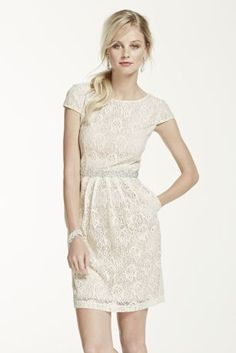 This short and sassy lace dress has tons feminine appeal!  Cap sleeve all over lace dartbodice with scoop neckline features dazzling tuckedbeaded waist.  Slim skirt with side pockets is ultra-chic.  Fully lined. Back zip. Imported polyester/cotton/nylon blend.  Hand wash cold. Wash dark colors separately. Do not wring or twist. No bleach. Lay flat to dry. Low iron.