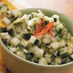 This unique salsa tastes terrific with chicken and fish, on top of baked potatoes or eaten as a dip with tortilla chips. | Lime Cucumber Salsa Recipe from Taste of Home