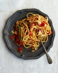 Linguine with Clams, Bacon, and Tomato - Clams and bacon form a delectable union enhanced by wine-flavored tomato sauce. Food & Wine recommends chopped clams, which are sold in refrigerated containers in many fish shops and at supermarkets, but you can also use good-quality canned clams.