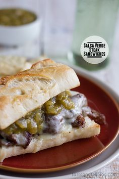 Salsa Verde Steak Sandwiches - hearty and filling, these sandwiches are piled with cooked steak, cheese and a homemade salsa verde sauce. On Taste and Tell
