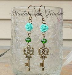 Bronze Key and Light Blue Rose Dangle Earrings